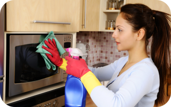 caregiver cleaning the kitchen
