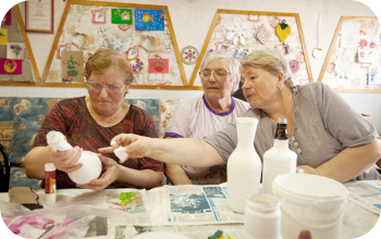 elderly people doing artwork